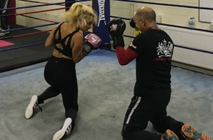 Kate Farley boxing on her knees